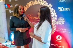 Olive Karmen (left) attending the Donatella EP launch