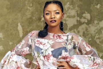 Simi Unveils Album Cover For 'Omo Charlie Champagne'
