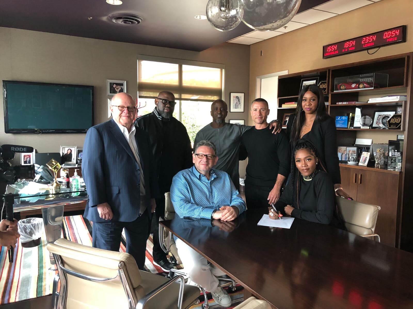 Tiwa Savage signing new deal at UMG office