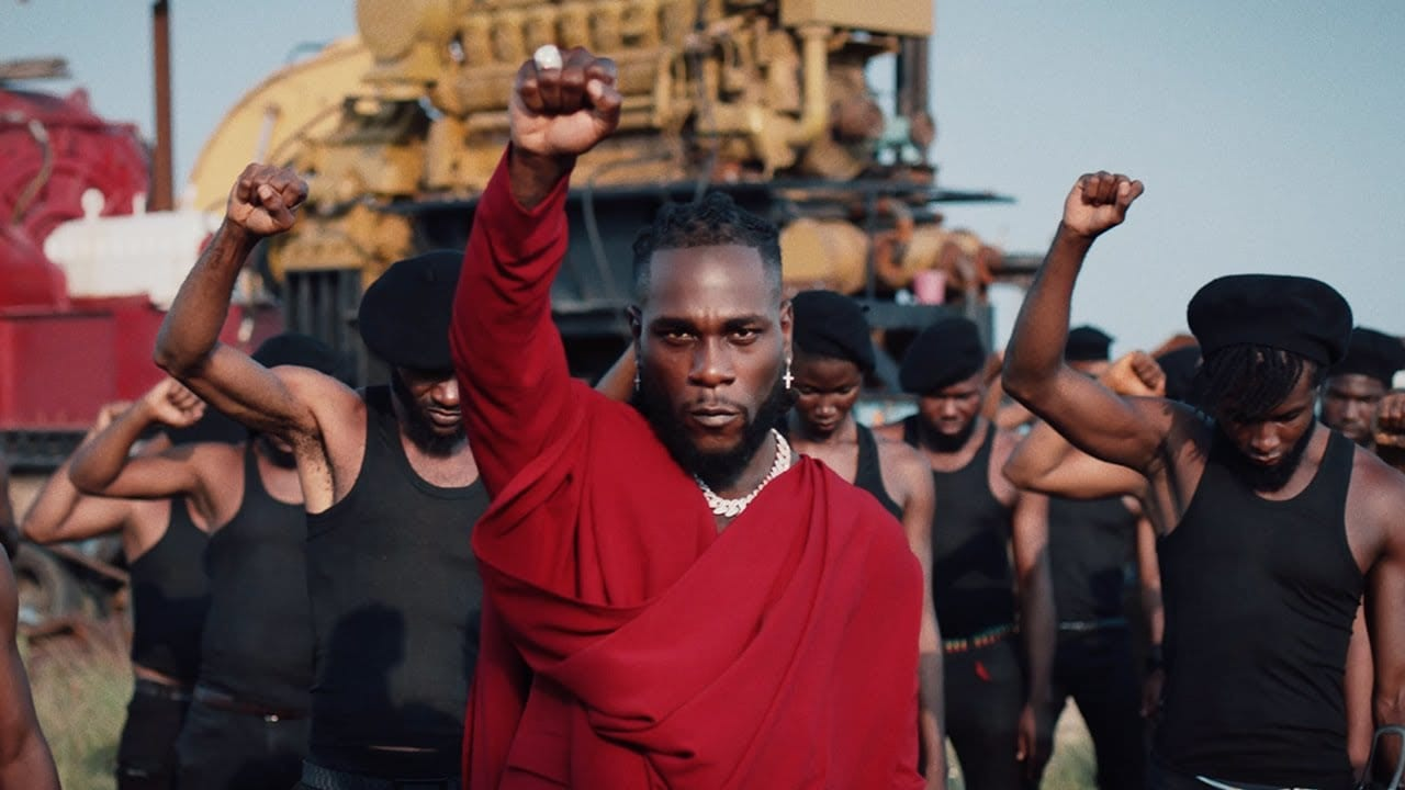 "Burna Boy Teams Up With Coldplay's Chris Martin For ""Monsters You Made"" Video"