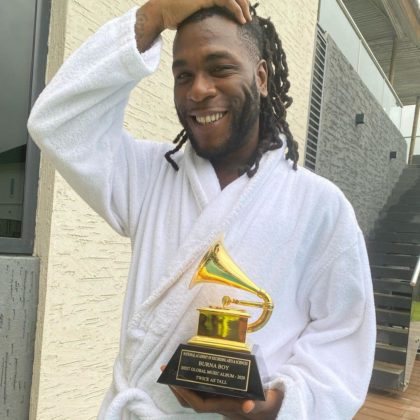 Burna Boy Takes Possession of Grammy Plaque | WATCH