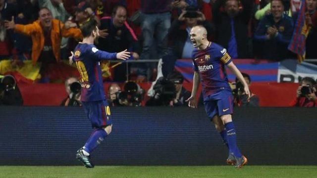 Iniesta and Messi celebrating
