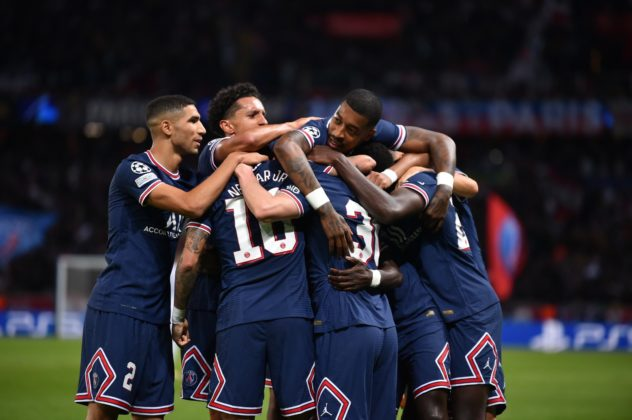 PSG players celebrating Messi's goal